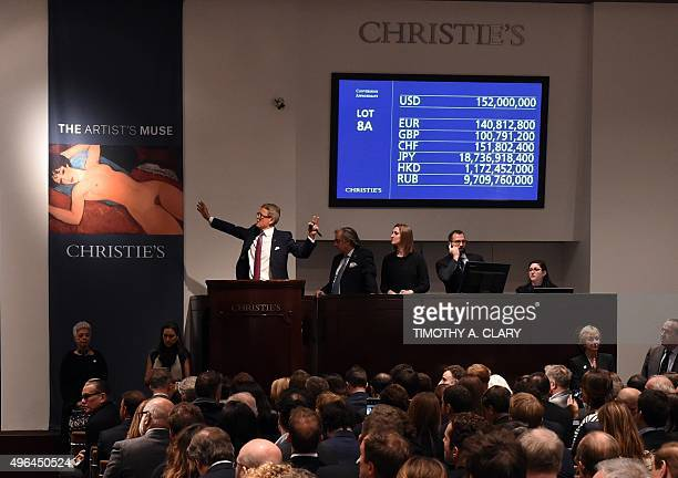 Auctioneer Jussi Pylkkanen holds his hands up as he sells Amedeo Modigliani's 'Nu couche' during the 'Artist Muse A Curated Evening Sale' November 9...