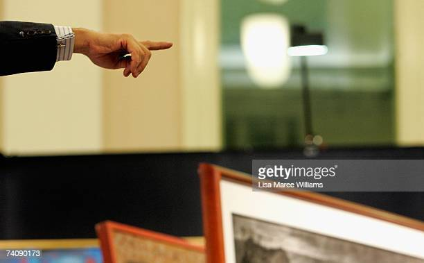 Auctioneer Justin Miller accepts a bid at the Sotheby's auction of important Australian paintings May 7 2007 in Sydney Australia