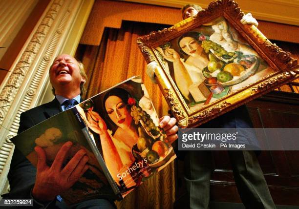 Auctioneer Lord Poltimore holds a catalogue alongside John Duncan Fergussons' The Pink Box one of the works on offer at the Scottish and Sporting...