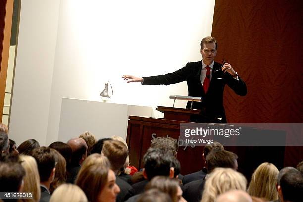 Auctioneer Oliver Barker speaks onstage at Jony And Marc's Auction at Sotheby's on November 23 2013 in New York City Photo by Theo Wargo/Getty Images...