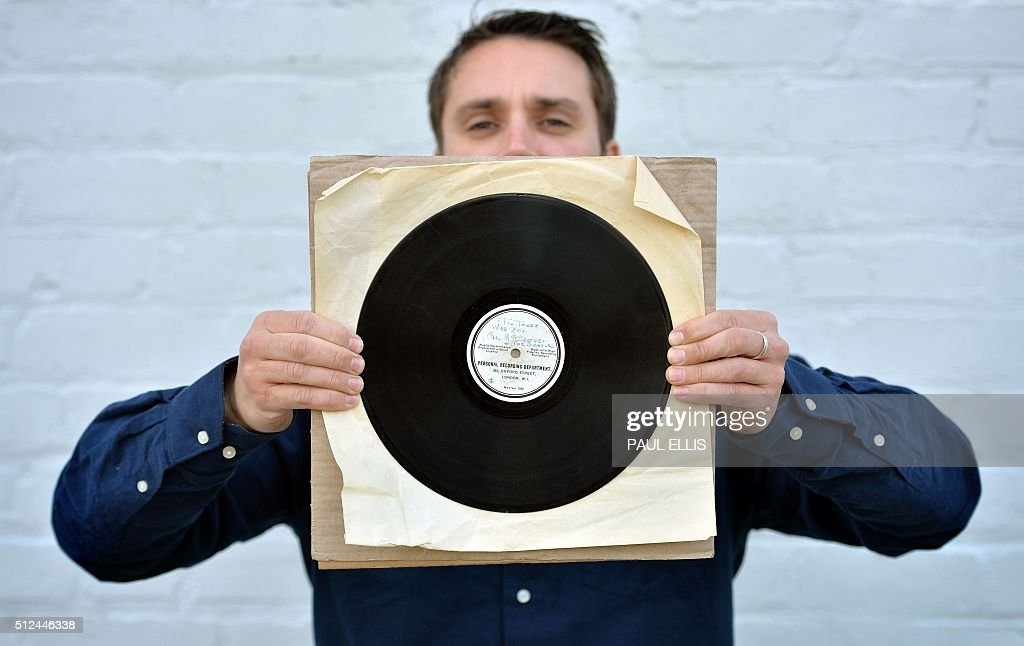 Auctioneer Paul Fairweather displays an original 10inch 78RPM acetate recording of 'Till There Was You' and 'Hello Little Girl' by The Beatles at his...