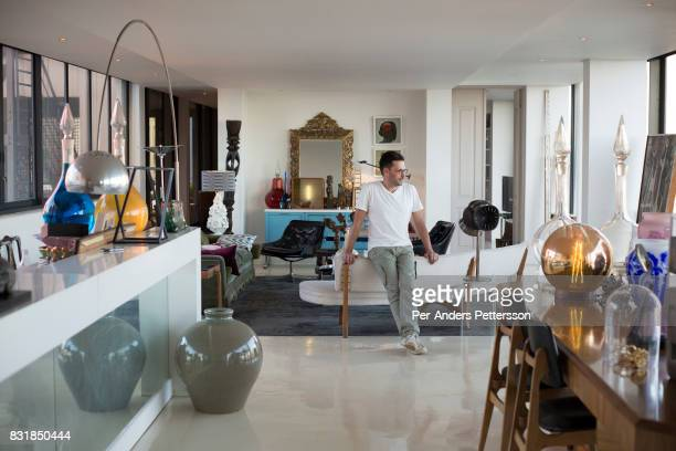 Auctioneer Russell Kaplan sits in his loft apartment on March 18 2016 in Braamfontein in downtown Johannesburg South Africa The area a culture hub...