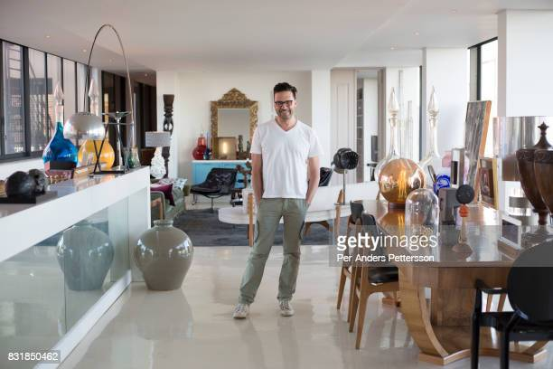 Auctioneer Russell Kaplan stands in his loft apartment on March 18 2016 in Braamfontein in downtown Johannesburg South Africa The area a culture hub...