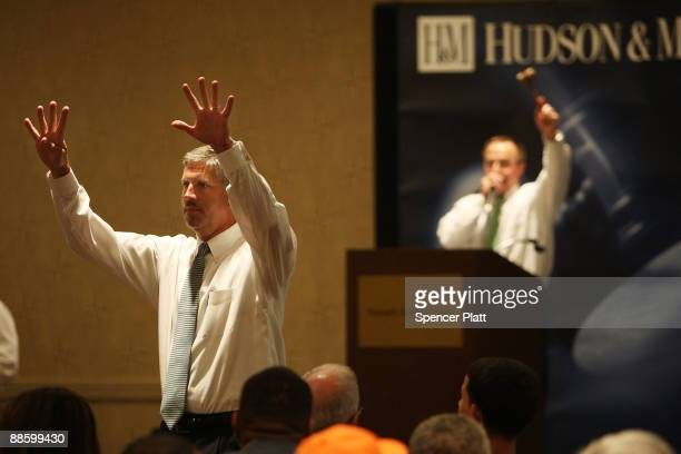 Auctioneers from Hudson Marshall take bids during a auction for more than 25 forclosed homes at the Renaissance Newark Airport Hotel on June 20 2009...
