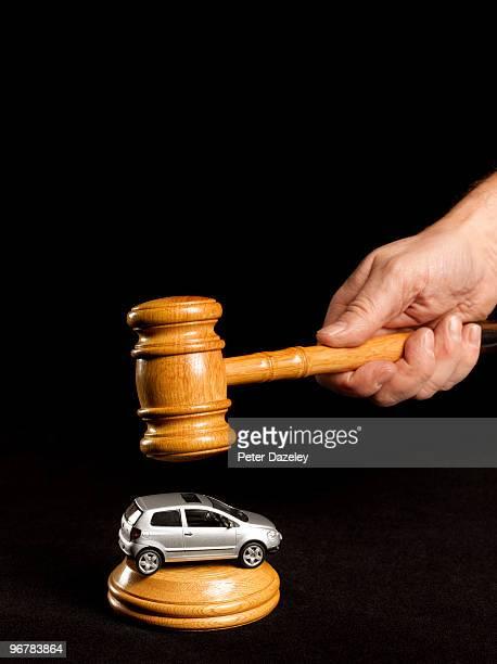 Auctioneer's gavel on car