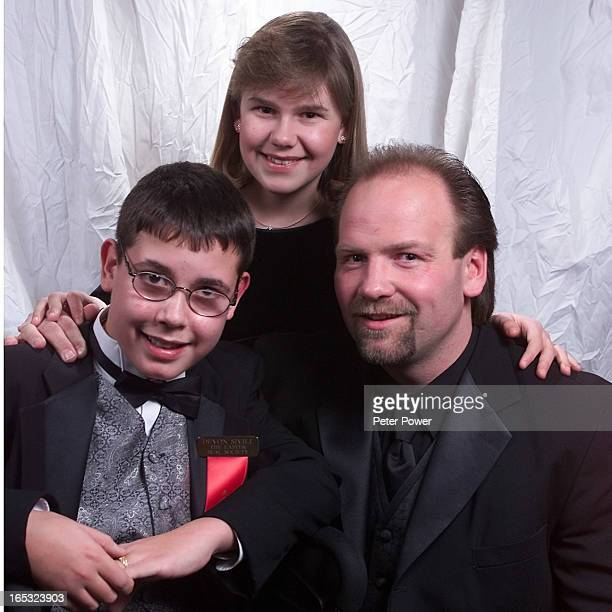 Maple Leaf great Wendel Clark with this year's 2001 Easter Seal Ontario Ambassadors Devon Sivill from Mount Forest left and Jessica Field from...
