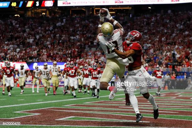Auden Tate of the Florida State Seminoles makes a catch for a touchdown as Minkah Fitzpatrick of the Alabama Crimson Tide defends in the second...
