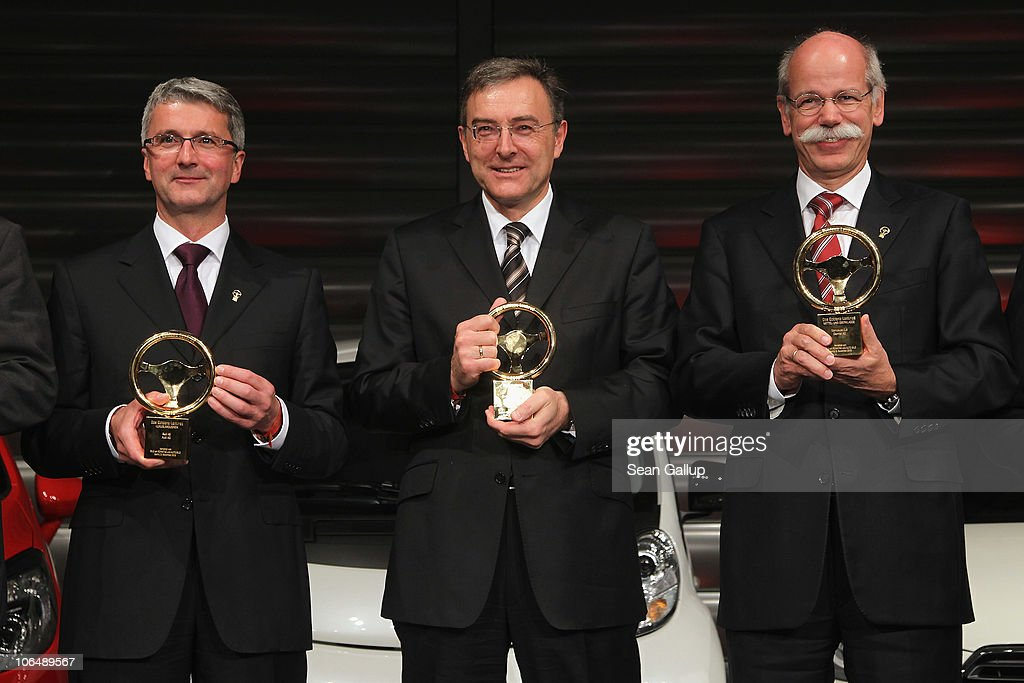 Audi AG Chairman <a gi-track='captionPersonalityLinkClicked' href=/galleries/search?phrase=Rupert+Stadler&family=editorial&specificpeople=870122 ng-click='$event.stopPropagation()'>Rupert Stadler</a>, BMW Group Chairman <a gi-track='captionPersonalityLinkClicked' href=/galleries/search?phrase=Norbert+Reithofer&family=editorial&specificpeople=885003 ng-click='$event.stopPropagation()'>Norbert Reithofer</a> and Daimler AG Chairman <a gi-track='captionPersonalityLinkClicked' href=/galleries/search?phrase=Dieter+Zetsche&family=editorial&specificpeople=241297 ng-click='$event.stopPropagation()'>Dieter Zetsche</a> attend the 2010 Das Goldene Lenkrad awards at Axel Springer Haus on November 3, 2010 in Berlin, Germany.