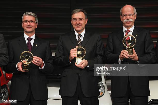Audi AG Chairman Rupert Stadler BMW Group Chairman Norbert Reithofer and Daimler AG Chairman Dieter Zetsche attend the 2010 Das Goldene Lenkrad...