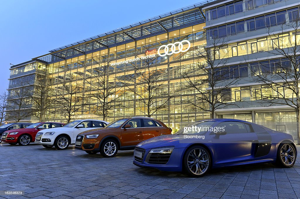 Audi automobiles stand in a line as light illuminates the Audi AG plant, a unit of Volkswagen AG in Ingolstadt, Germany, on Monday, March 11, 2013. Audi AG, the world's second-biggest luxury carmaker, is aiming for a 'slight' increase in revenue this year and reaching an operating margin at the upper end of its long-term target corridor, helped by sales of compact SUVs and the new A3 sedan. Photographer: Guenter Schiffmann/Bloomberg via Getty Images