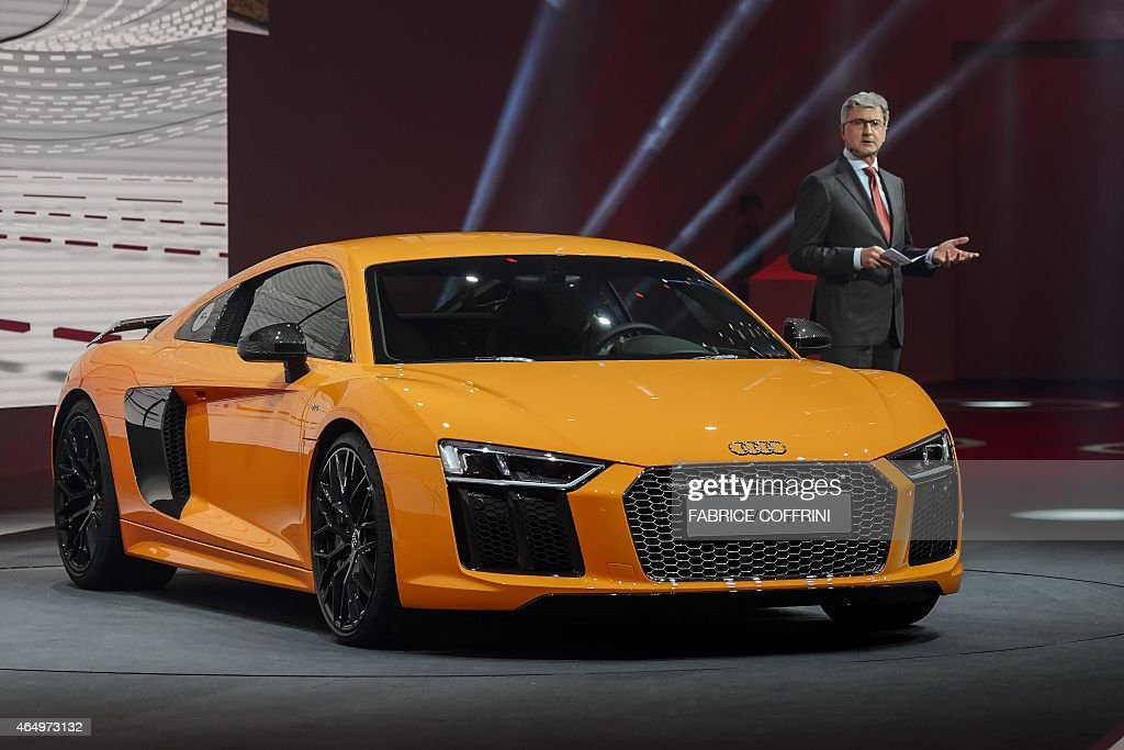 Audi chairman Rupert Stadler presents the new Audi R8 V10 plus during a preview of German carmaker Volkwagen Group on March 2, 2015 ahead of the Geneva Car Show in Geneva.