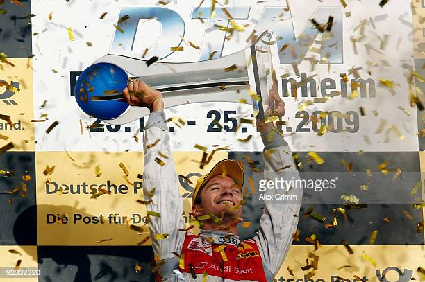 Audi driver Timo Scheider of Germany celebrates after winning the overall competition of the DTM 2009 German Touring Car Championship at the...