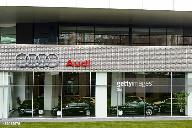Audi luxury car dealership with various Audi models inside