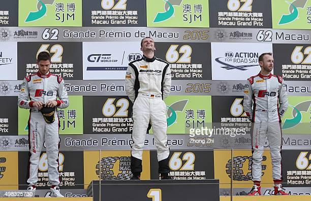 Audi R8 LMS driver Edoardo Mortara of Italy MercedesBenz SLS AMG GT3 driver Maro Engel of Germany and Audi R8 LMS driver Rene Rast of Germany pose on...