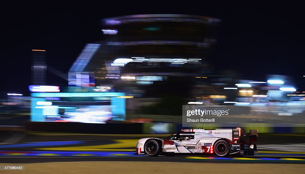 Audi Sport Team Joest driven by Marcel Fassler, <a gi-track='captionPersonalityLinkClicked' href=/galleries/search?phrase=Andre+Lotterer&family=editorial&specificpeople=2380096 ng-click='$event.stopPropagation()'>Andre Lotterer</a> and <a gi-track='captionPersonalityLinkClicked' href=/galleries/search?phrase=Benoit+Treluyer&family=editorial&specificpeople=4333474 ng-click='$event.stopPropagation()'>Benoit Treluyer</a> during the Le Mans 24 Hour race at the Circuit de la Sarthe on June 13, 2015 in Le Mans, France.