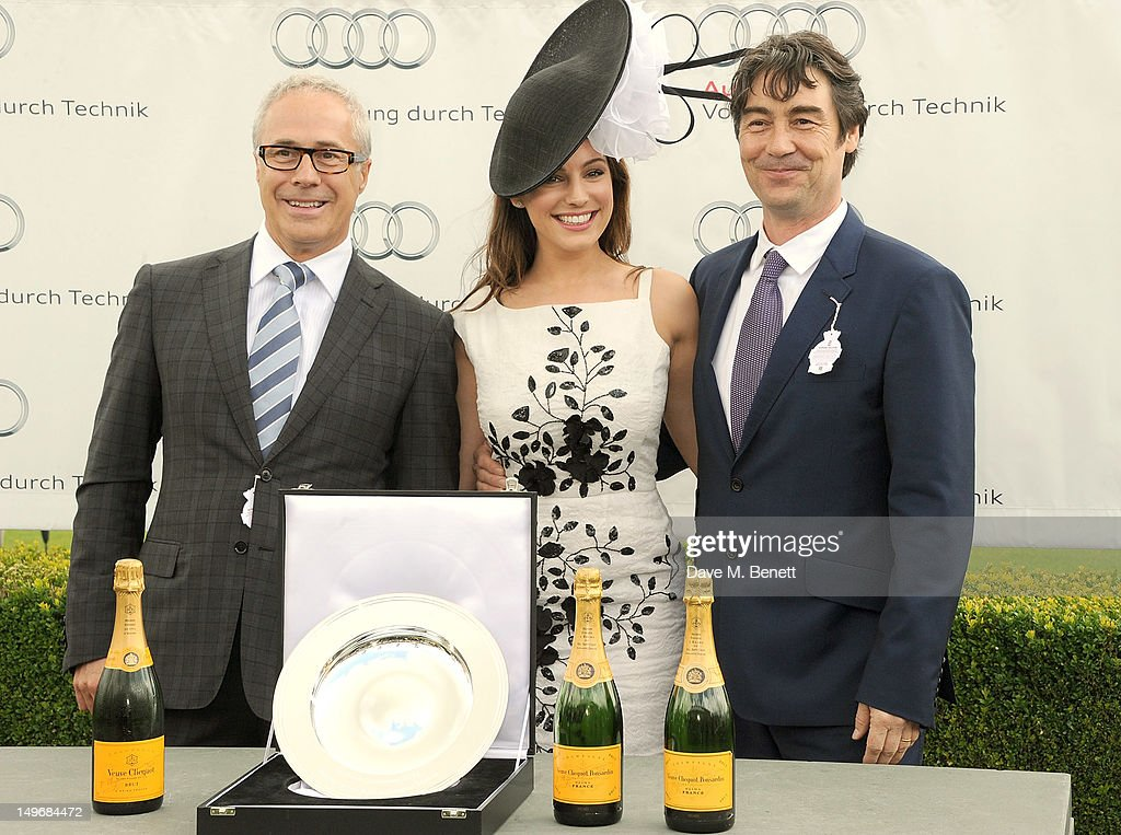 Audi UK Head of PR Jon Zammett, <a gi-track='captionPersonalityLinkClicked' href=/galleries/search?phrase=Kelly+Brook&family=editorial&specificpeople=206582 ng-click='$event.stopPropagation()'>Kelly Brook</a> and Nat Parker present the Audi Richmond Stakes during Ladies Day at Glorious Goodwood held at Goodwood Racecourse on August 2, 2012 in Chichester, England.