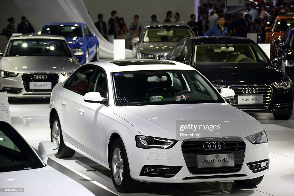 Audi vehicles stand on display at the FAW Audi booth, the joint venture between Audi AG, Volkswagen AG, and FAW Group Corp., stand on display at the Wuhan Motor Show 2013 in Wuhan, China, on Saturday, Oct. 19, 2013. The show will be held through Oct. 23. Photographer: Tomohiro Ohsumi/Bloomberg via Getty Images