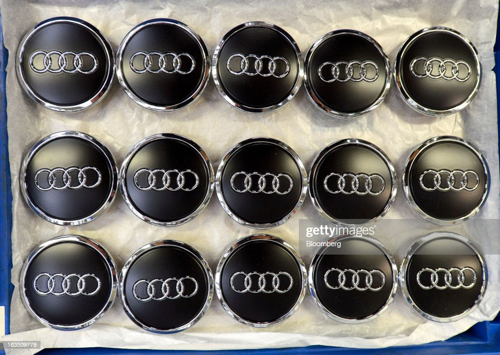 Audi-branded wheel hub badges for Audi A3 automobiles, produced by Volkswagen AG's Audi brand, sit alongside the production line at the company's plant in Ingolstadt, Germany, on Monday, March 11, 2013. Audi, the world's second-largest maker of luxury vehicles, plans to spend 13 billion euros ($17 billion) through 2016 to develop new cars and expand production capacity as it pursues Bayerische Motoren Werke AG's sales lead. Photographer: Guenter Schiffmann/Bloomberg via Getty Images