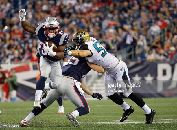 Audie Cole of the Jacksonville Jaguars reaches for LeShun Daniels of the New England Patriots in the second half during a preseason game against the...