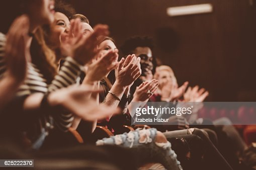 Audience applauding in the theater