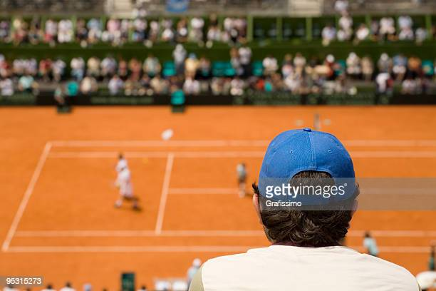 Audience at tennis match