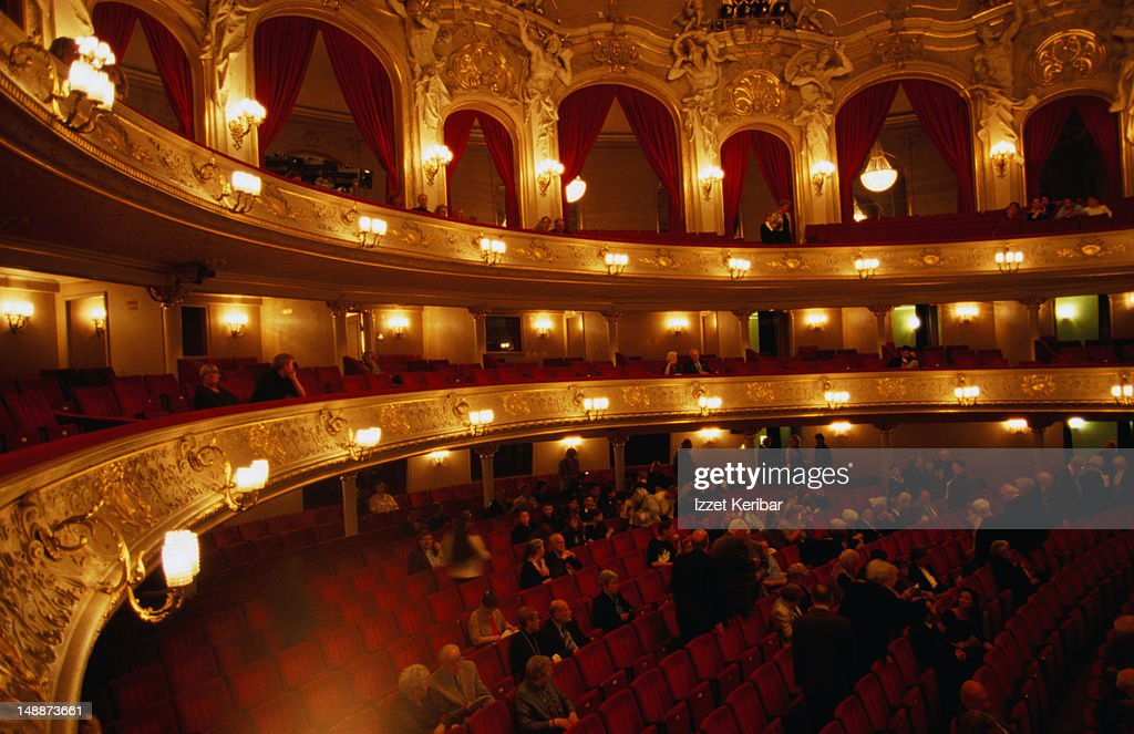 Audience being seated for opera performance.