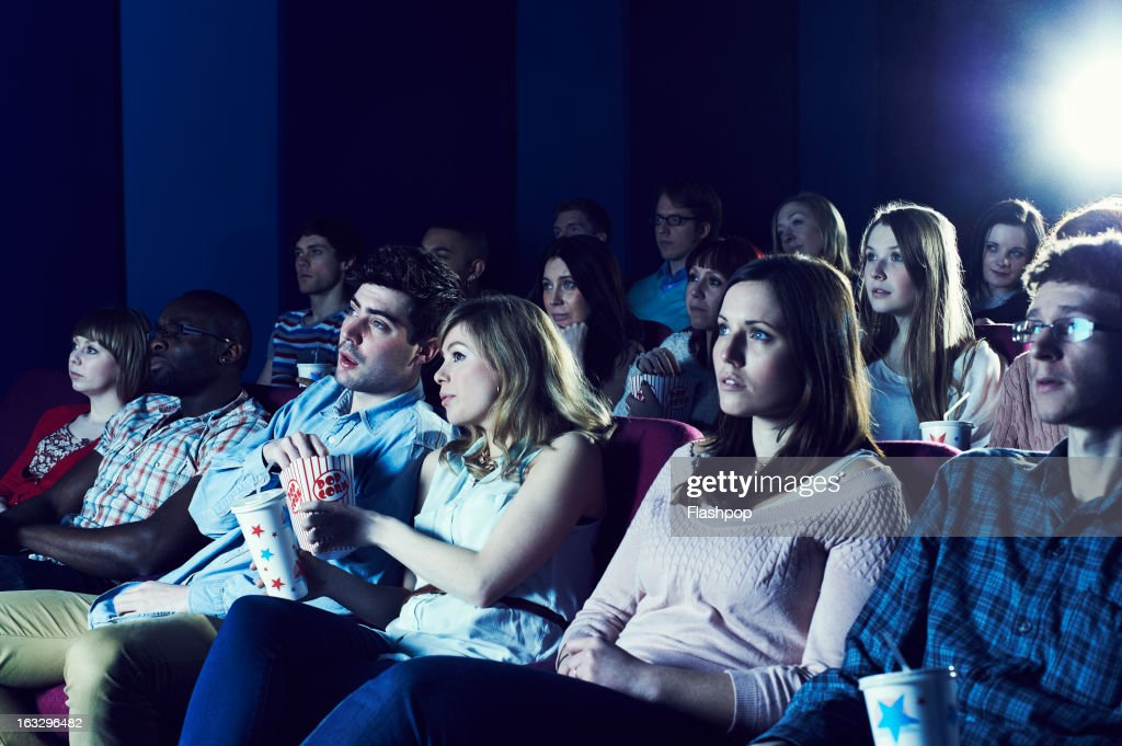 Audience enjoying movie at the cinema