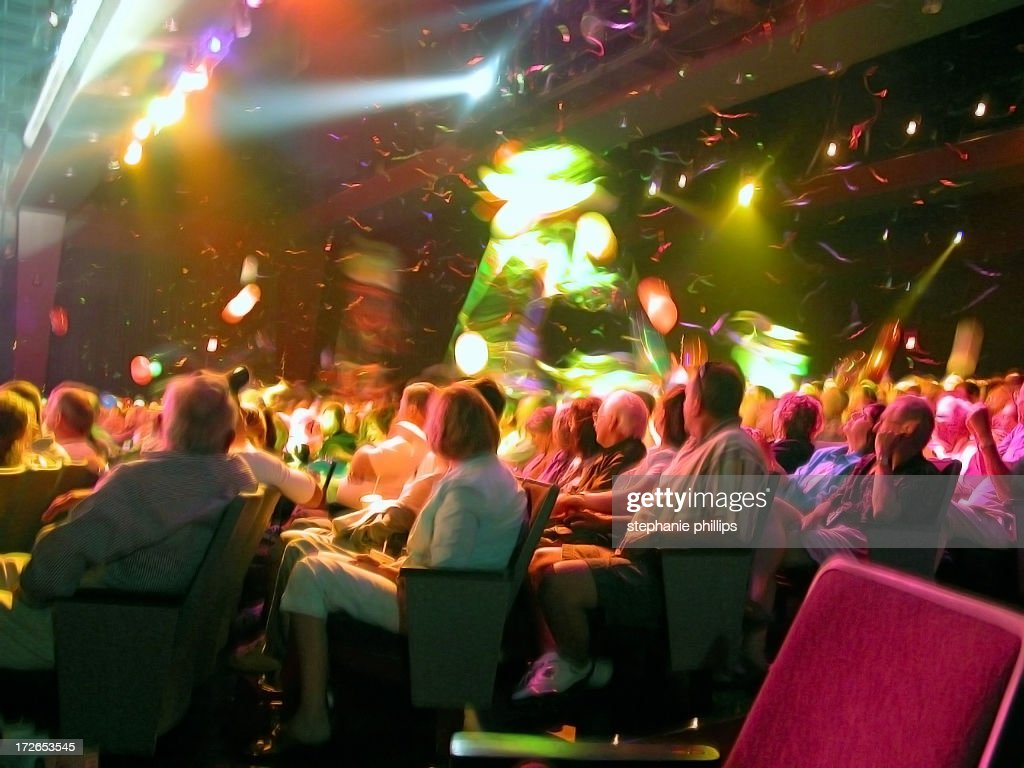 Audience in Theater Seating with Confetti Floating Down : Stock Photo