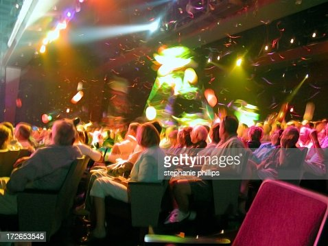 Audience in Theater Seating with Confetti Floating Down