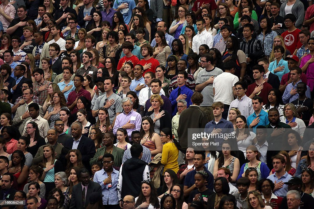 Audience member stand for the the Pledge of Allegiance before U.S. President Barack Obama delivers a speech on gun control at the University of Hartford on April 8, 2013 in West Hartford, Connecticut. Nearly four months after the Sandy Hook Elementary School shootings, Connecticut has passed some of the toughest gun control measures in the nation.
