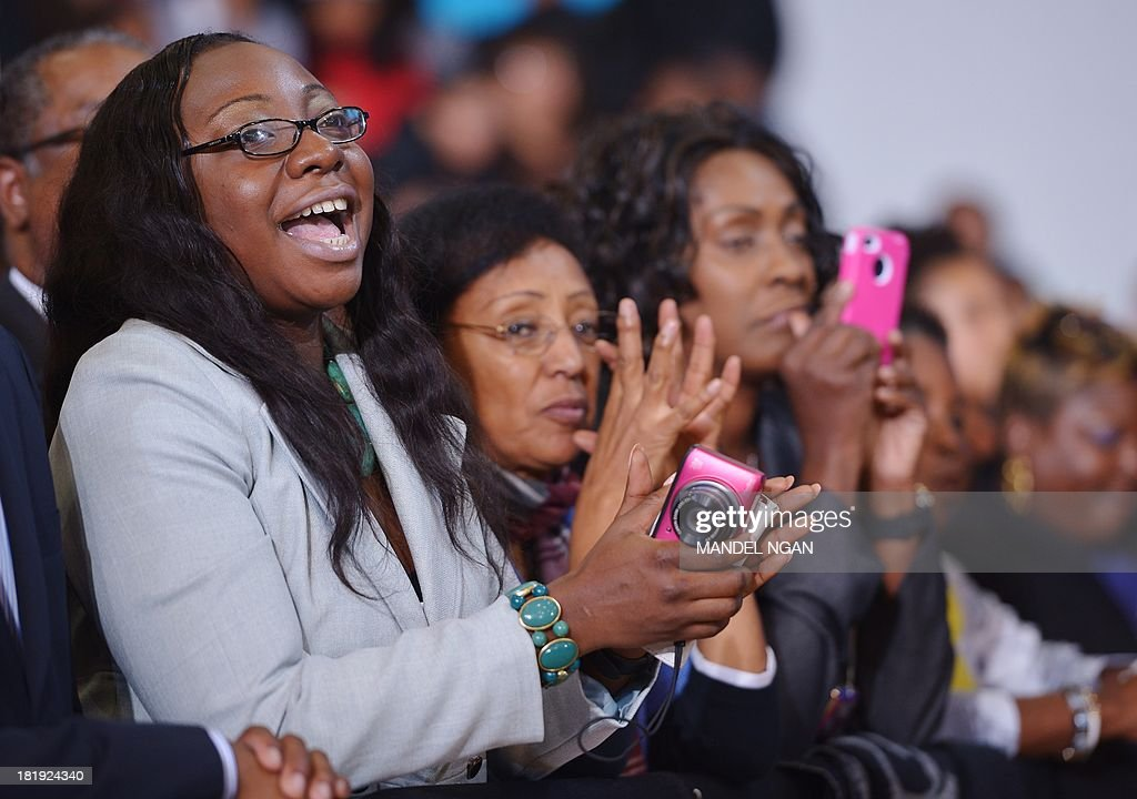 Audience members applaud as US President Barack Obama speaks on the Affordable Care Act at Prince Georges Community College on September 26, 2013 in Largo, Maryland. AFP PHOTO/Mandel NGAN