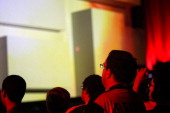 Audience members are illuminated by the demonstration of a new game at the Sony 'press conference' on the eve of the Electronic Entertainment Expo on...