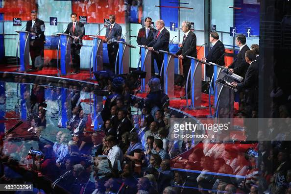 Audience members are reflected in a window as Republican presidential candidates New Jersey Gov Chris Christie Sen Marco Rubio Ben Carson Wisconsin...