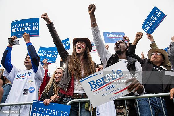 Audience members at a rally held by Democratic presidential candidate Senator Bernie Sanders at the Presidio cheer while waiting for Sanders to...