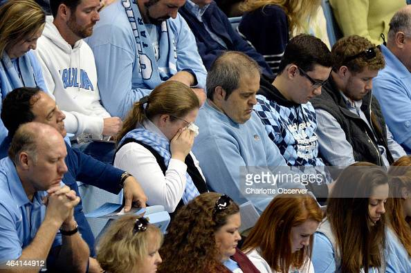 Audience members bow their heads at the Dean E Smith Center during the public memorial service for Dean Smith entitled 'A celebration of the...