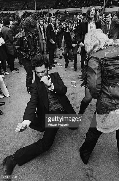 Audience members get into the spirit of the London Rock 'n' Roll Revival at Wembley Stadium 5th August 1972