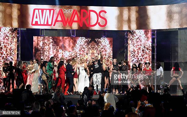 Audience members join rapper Flo Rida on stage as he performs during the 2017 Adult Video News Awards at The Joint inside the Hard Rock Hotel Casino...