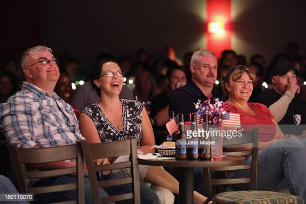 Audience members laugh as comedian and wounded US Army veteran Bobby Henline performs at the 'Humor For Heroes' charity event at the Laugh Out Loud...