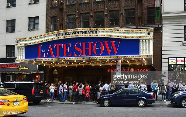 Audience members line up at the Ed Sullivan Theater before entering to see the taping of The Late Show with Stephen Colbert television show The...