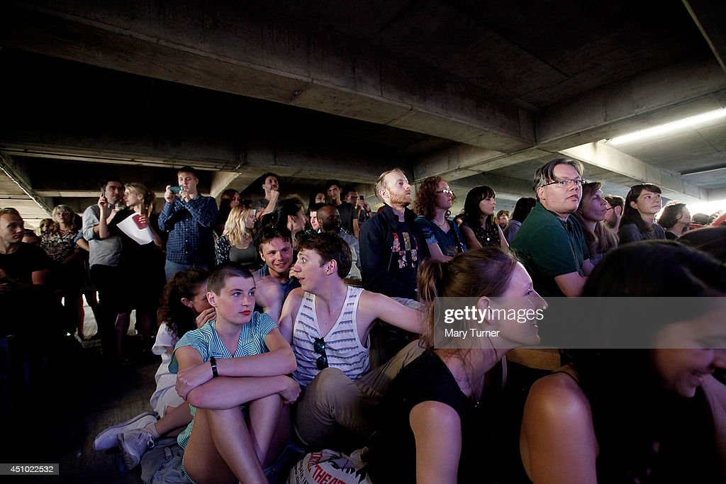 Audience members listen to The Multi-Story Orchestra perform Jean Sibelius' 5th Symphony at the Peckham Rye Car Park on June 21, 2014 in London, England. The performance is one of a series that the orchestra will be performing in the South London car park throughout the summer, hoping to bring classical music to new audiences.