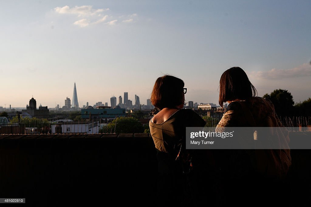 Audience members look out over the London skyline viewed from Peckham Rye car park where they listened to The MultiStory Orchestra perform Jean...