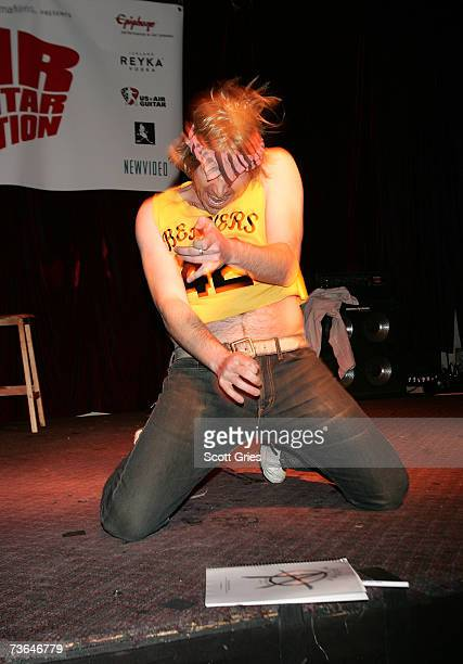 Audience members perform during an air guitar competition during the afterparty for 'Air Guitar Nation' at The Cutting Room on March 20 2007 in New...
