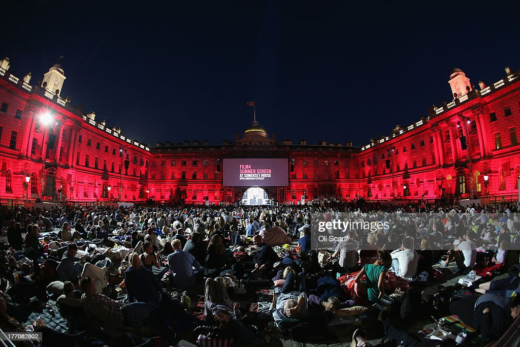 Audience members prepare to watch an openair screening of 'Butch Cassidy and the Sundance Kid' in the courtyard of Somerset House on August 20 2013...