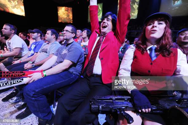 Audience members react to a play during a League of Legends professional match at the League of Legends North American Championship Series Spring...