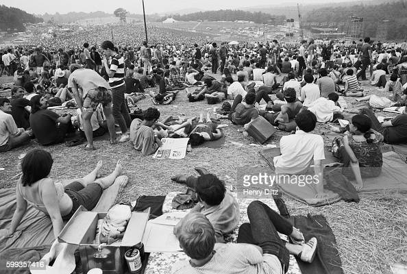 Audience members sit out of view of the stage at the free Woodstock Music and Art Fair The festival took place on Max Yasgur's dairy farm which he...