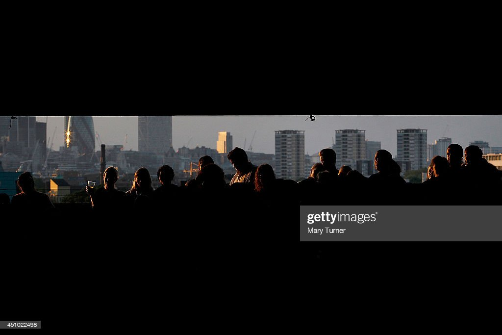 Audience members stand in front of the London skyline as they listen to The Multi-Story Orchestra perform Jean Sibelius' 5th Symphony at the Peckham Rye Car Park on June 21, 2014 in London, England. The performance is one of a series that the orchestra will be performing in the South London car park throughout the summer, hoping to bring classical music to new audiences.