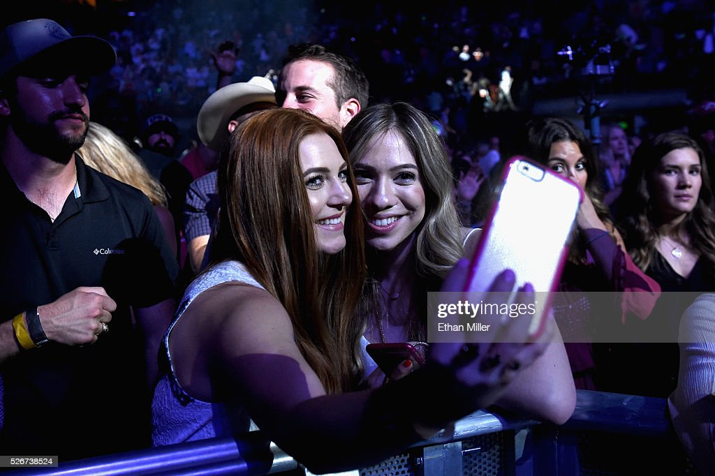 Audience members take selfies during the 2016 iHeartCountry Festival at The Frank Erwin Center on April 30, 2016 in Austin, Texas.