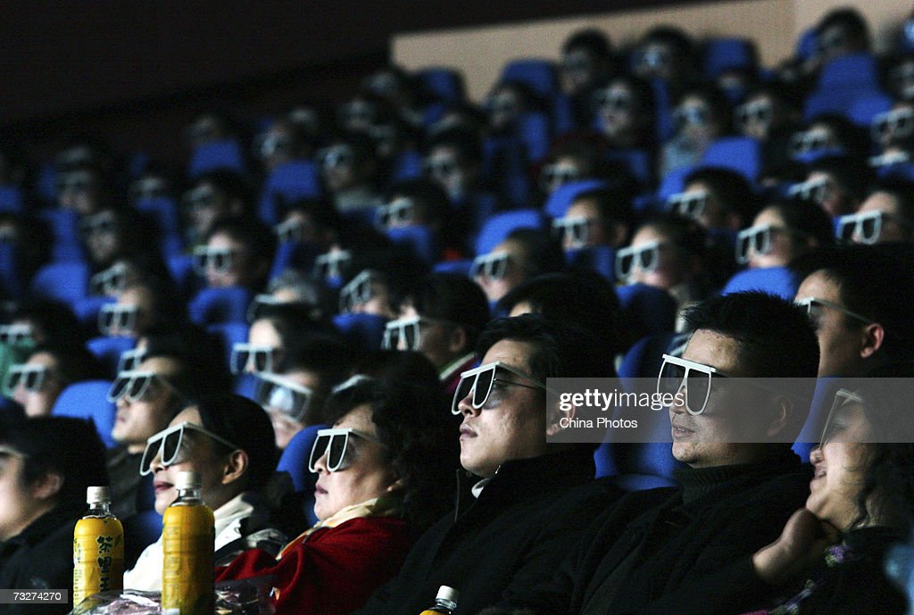 Audience members watch a movie through 3D glasses at a newly opened IMAX theatre on February 8 2007 in Wuhan of Hubei Province China IMAX Corporation...
