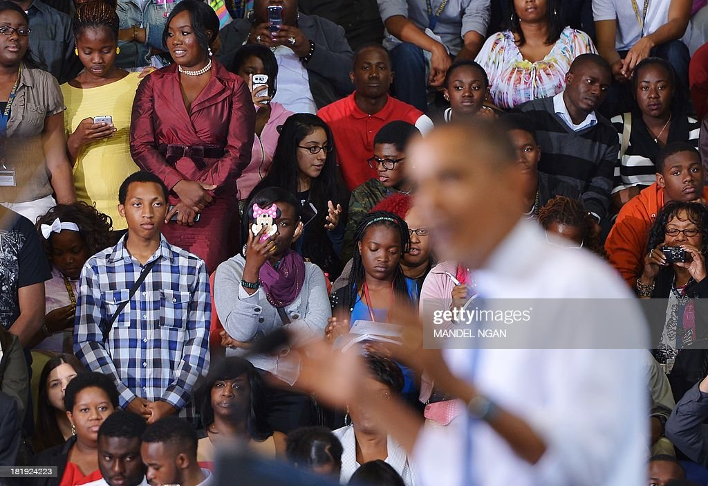 Audience members watch as US President Barack Obama speaks on the Affordable Care Act at Prince Georges Community College on September 26, 2013 in Largo, Maryland. On October 1, 2013, open enrollment starts for the new Obamacare online, state-based exchanges, where consumers will be able to compare and shop for private health insurance plans. AFP PHOTO/Mandel NGAN