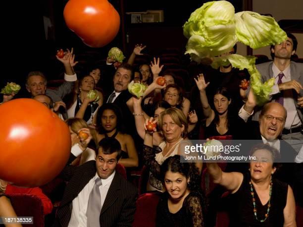 Audience throwing vegetables at performers